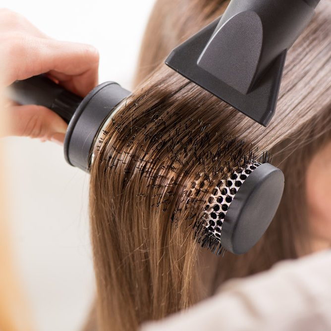stock-photo-drying-long-brown-hair-with-hair-dryer-and-round-brush-close-up-197226602